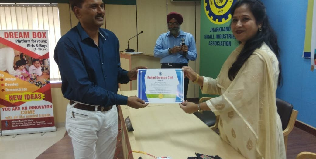 Honouring Life Members by giving away certificates